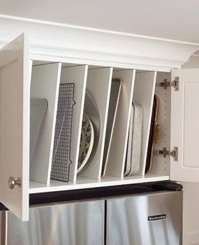 What do you with that awkward space above your fridge? Turn it into a storage unit for platters, pans, cutting boards, cookie sheets, and more! Brilliant.