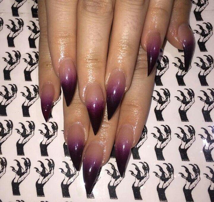 Purple ombre stiletto nails.