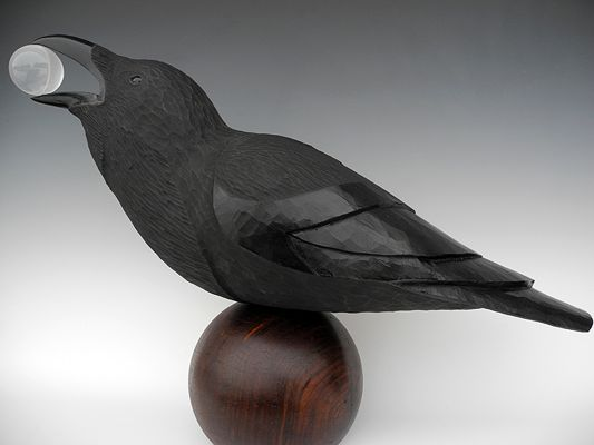 Raven Sculpture Life size. This raven was carved out of pine and has a crystal sphere in it's mouth. He sits on a vintage lignum vitae bowling ball. By TJ McDermott. ~Sculpture~