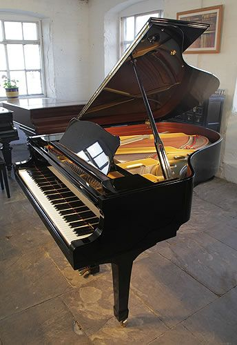 A 1986, Yamaha C3 Conservatory grand piano for sale with a black case and spade legs at Besbrode Pianos. Piano has an eighty-eight note keyboard anda three-pedal lyre.