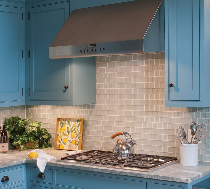 Pale Frosted Blue Glass Tile Coordinates With Custom Cabinets And Reflects  This Ocean Side Setting