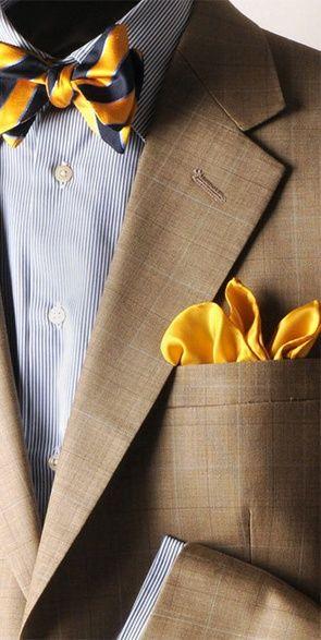 Tan plaid jacket, white shirt with navy dress stripes, navy  yellow striped bow tie