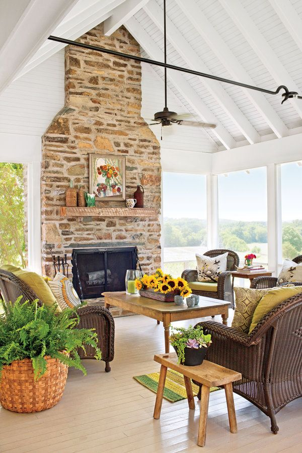The porch's vaulted ceiling rises to 15 feet, which is 6 feet higher than the flat-ceilinged breezeway.    SourcesChimney and fireplace masonry: by Randy Sells Stone Masonry, Inc., Richfield, NC