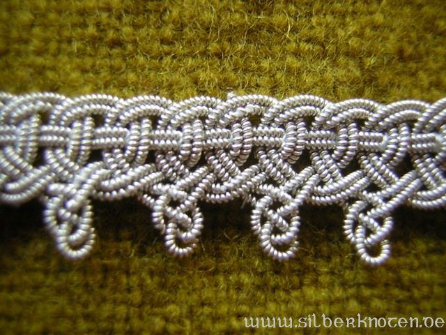 viking  Border braid originally made from double-running silver spiral filament. Replica manufactured from spiral filament with a small silver share. Sewed on the fabric's edge this braid equally served to decorate and avoid the fabric's edge from fraying out. Fragments of twill silk were found on the upper edge of the original.