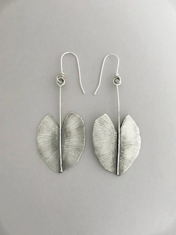 Handcrafted sterling silver leaf earrings. Each one is made one at a time and hand textured. Please see the thumbnails and read the description below.  All my ear wires are sterling silver and handmade by me.  The length of these earrings from the top of the ear wire are 2.5  The