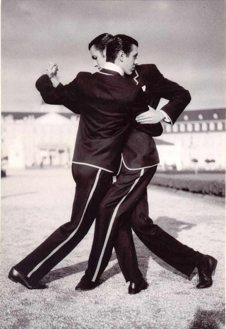 Gay man dancing during the desfile de llamadas in carnival in the stock photo