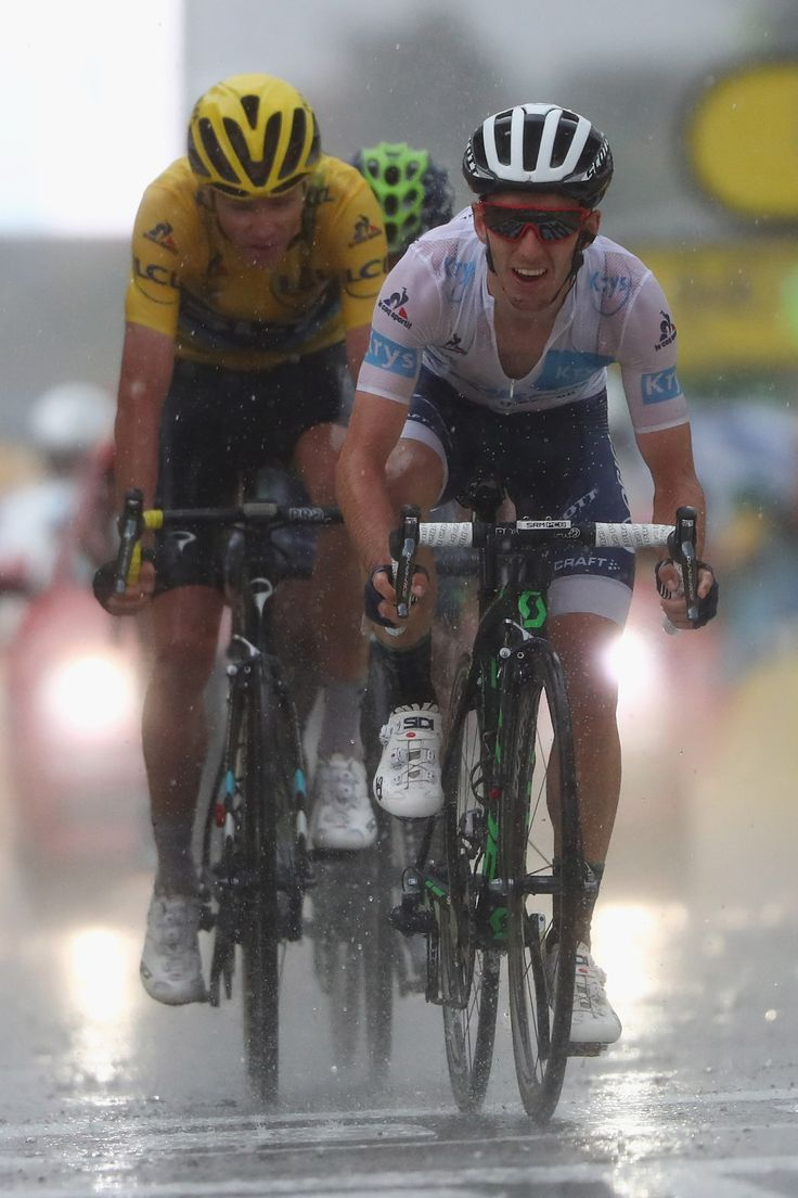 Adam Yates of Great Britain and Orica Bike Exchange finishes ahead of Chris Froome (L) of Great Britain and Team Sky during the 184.5 km stage 9 of Le Tour de France from Vielha Val D'Aran to Andorre Arcalis on July 10, 2016 in Andorra la Vella, Andorra.