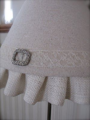 linen lampshade with burlap trim and a lace belt. Love it!