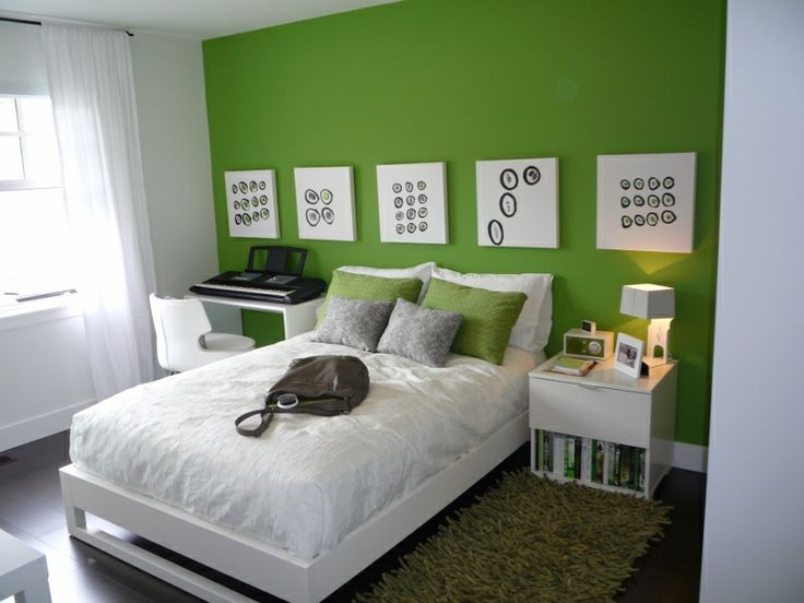 Staged bedroom in Coquitlam's Burke Mountain.  Bold Green feature wall with white accents make this a space to remember.