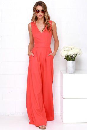 For those days that you want to look fabulous in no time, just step into the Wide Stride Coral Red Jumpsuit! The bright coral red woven fabric shapes a darted V neck bodice with wide straps that crisscross above a cutout at back. The fitted waistline sits atop chic, wide-cut pant legs with diagonal front pockets. Hidden side zipper. Short-length lining. 100% Polyester. Hand Wash Cold. Imported.