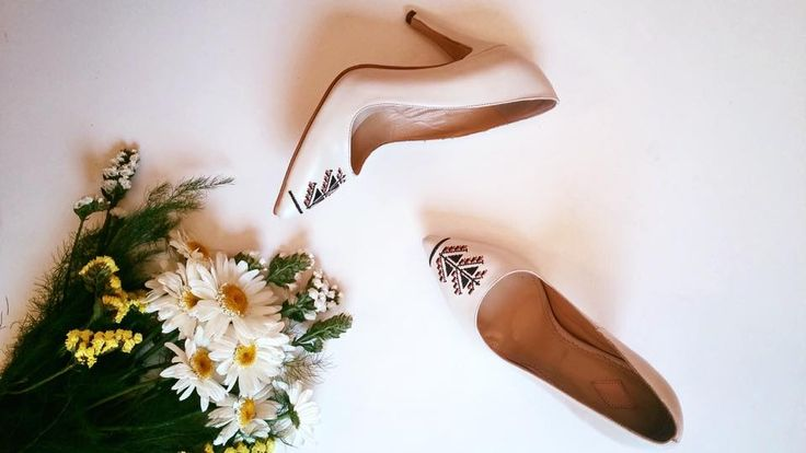Iutta's embroidered leather shoes in cream and with a tree of life symbol done in black and orange. Summer flowers complete the fashion photograph. #fashion #photography #leather #shoes #stilettos #iutta #joy #flatly