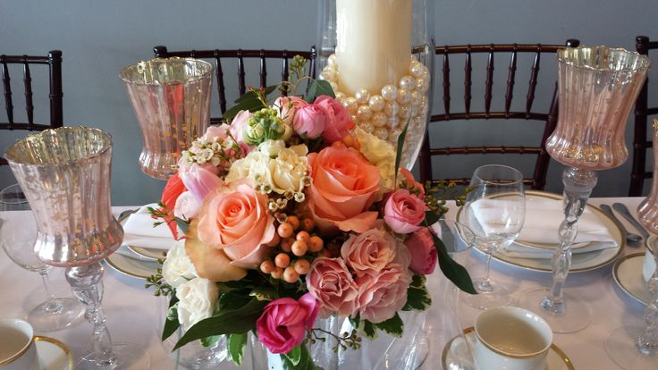 Peach, pink and coral; roses, hypericum, ranunculus, spray roses, waxflower.