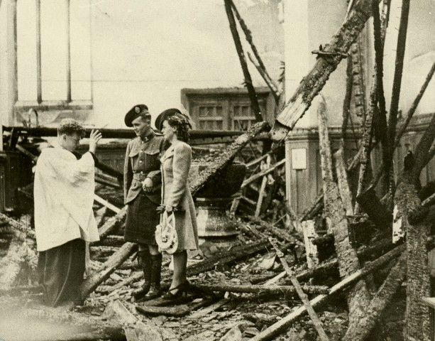 Helen Fowler and Cpl. Christopher Morrison of the 48th Canadian Highlanders stand amid the ruins of a bombed-out St. Bartholomew's to be wedded - UK - 1941
