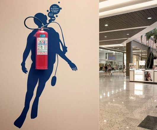 clever wall graphic around the mandatory fire extinguisher .. using what is there and fixed to inspire you