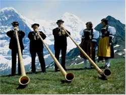 A few of the traditional Alphorns in action. It has been said that the instrument was first made 500 years ago. It takes an apprenticeship of around 2 years to play this difficult and heavy insturment in Switzerland.