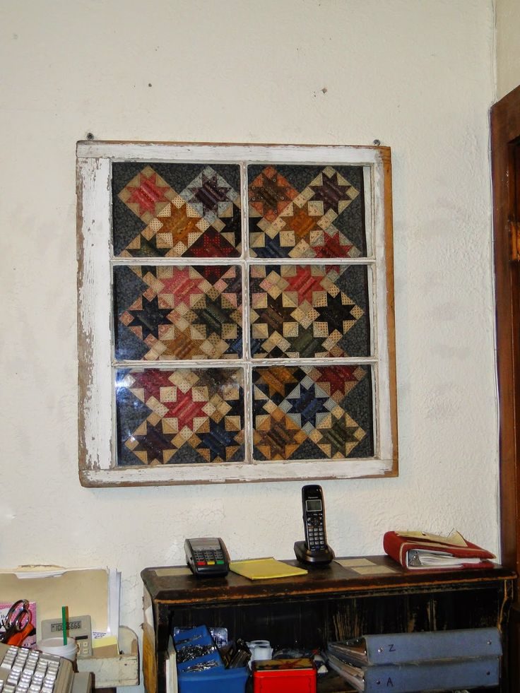 Heartspun Quilts ~ Pam Buda: My Visit To The Country Loft Quilt Shop....great display idea.