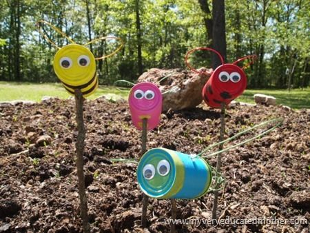 Tin Can Creatures4 via @Erin - My Very Educated Mother #upcycle #recycle #yardart