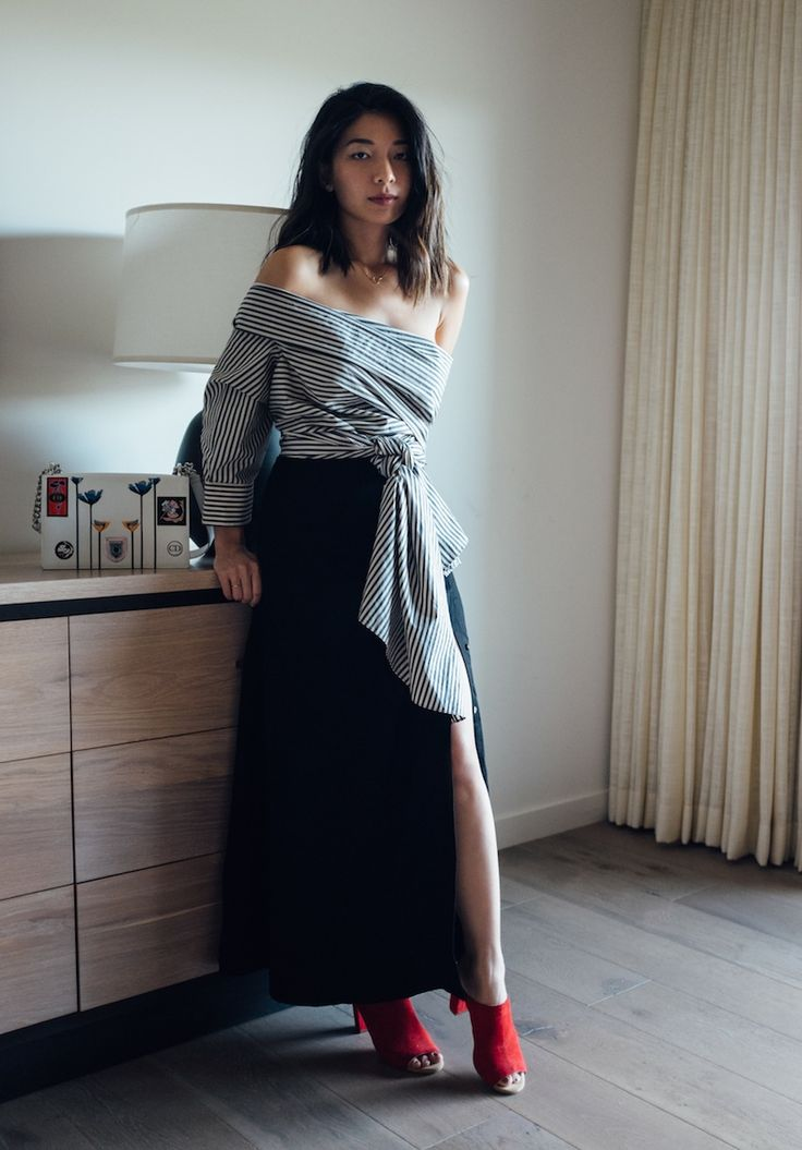 Stephanie Liu of Honey & Silk wearing Reem Al Kanhal top, Shaina Mote skirt, and Charlotte Stone heels