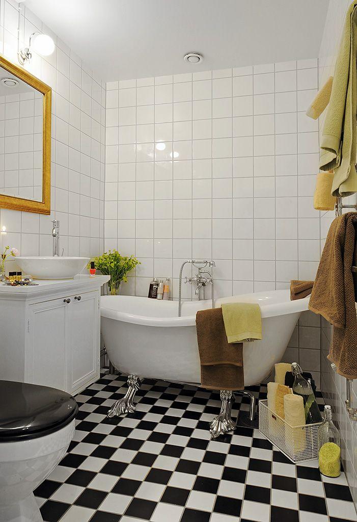 love a checker board floor & a claw foot tub