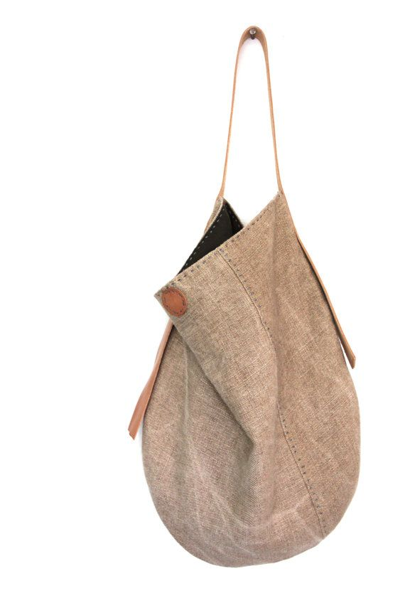 http://www.groslie.com  *Please note this is a made to order style & will take approx. 1-2 weeks to ship.  This classic, easy wearing slouch bag is handmade from a heavy, weighty Belgian linen that drips and drapes beautifully in a shade mimicking the sun kissed chaparral gorgeousness of the California coastline. Fully lined in eco brown linen with a generous interior pocket for your wallet & phone. The hand cut strap & antique magnetic snap closure cover is a natural, untreated tan leather…