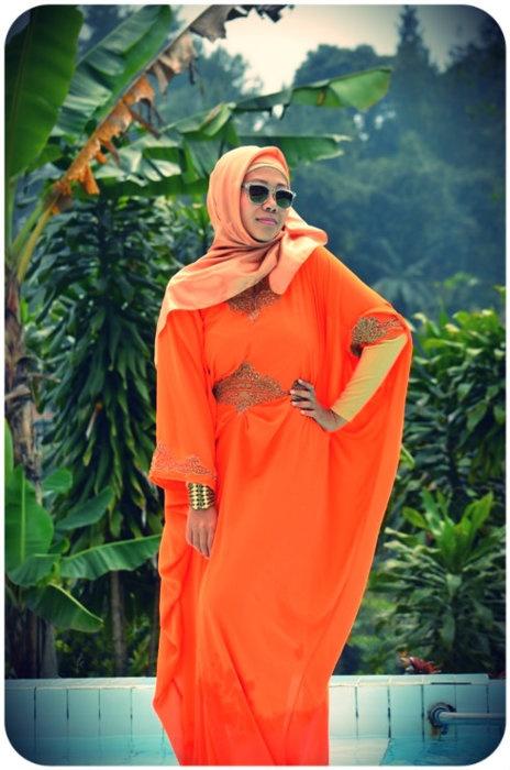 Orange sherbet colored kaftan and vintage shades