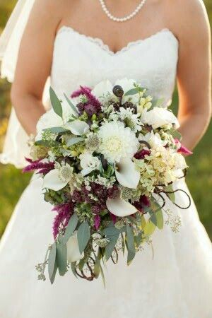 Bride's Bouquet Comprised Of: White Dahlias, White Calla Lilies, White Astrantia, White Spray Rose, Sangria Celosia, Fiddlehead Fern Shoots & Green Seeded Eucalyptus ••••