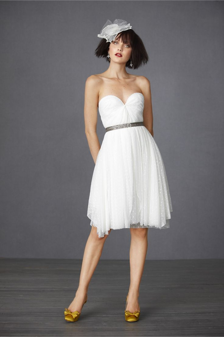 The perfect rehearsal dinner dress. Silver beaded belt, princess neckline, asymmetrically cut, polka dot chiffon dress. Oh yea and its in bridal white. Stunner