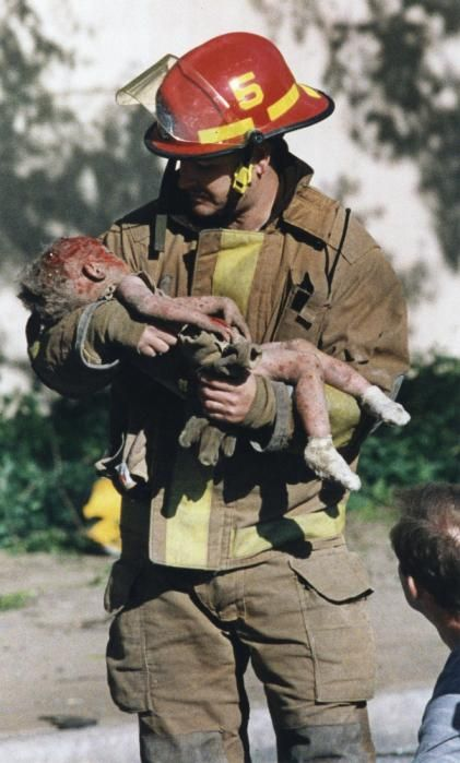 Oklahoma City federal building bombing – April 19, 1995/Chris Fields holds baby Angel Baylee Almon/This picture still brings tears to my eyes-20 yrs later.