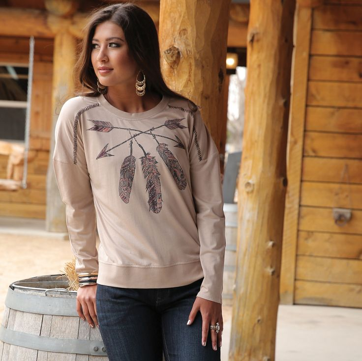 Cozy cotton-modal beige pullover with a burgundy contrast whipstitch along the shoulders. Bold feather screen print.