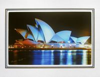 """Photo enlargement of the Sydney Opera House with Blue Sails, measuring 8"""" x 6"""" in a soft frame. You can buy this photo enlargement for $15.95 delivered. www.theshortcollection.com.au/page/photo-enlargement-small"""