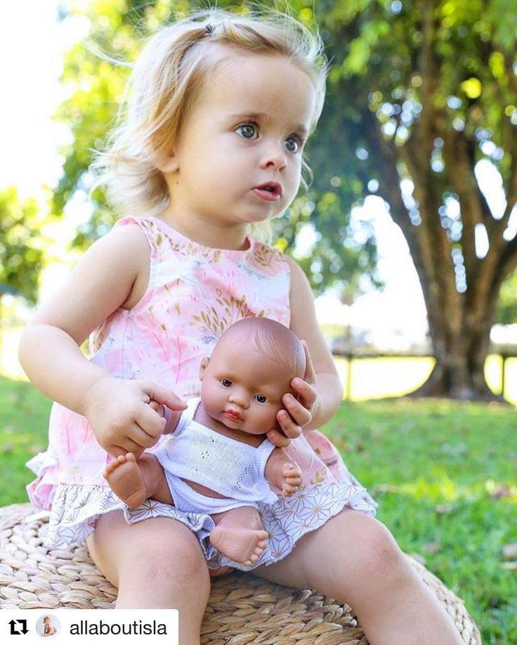 Isla and her Miniland baby doll are becoming great friends.  #letthechildrenplaytoyshop #educationaldolls #minilanddoll #babydolls