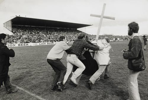 The protesters that stormed the Hamilton field erected a Christian cross, but the rugby fans took it down in anger.
