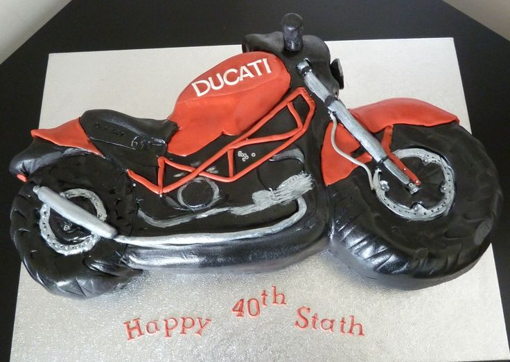 You dont quite see it in the photo, but the tyres on this Ducati motorcycle cake were nice and knobbly.  Theres a good amount of detail on the bike as well. Delivered to a pub this would have made a great centre piece for the party table.   2d Ducati Motorbike Birthday Cake