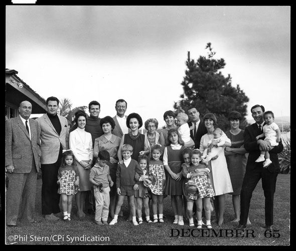 1965 Wayne gathers his extended family at his Marina del Rey home. Wayne, who was married three times, had seven children -- four from his marriage to first wife Josephine Alicia Saenz, daughter of the consul general of Panama in the U.S., and three with Pilar -- and 21 grandchildren. His second wife was Mexican actress Esperanza Baur.
