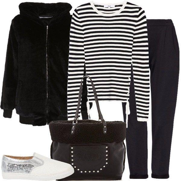 Total look formato da una giacca con cappuccio in nero, una maglia a righe  bianche e nere con fiocchetti, un paio di pantaloni in nero, una borsa  Gaudì e ...