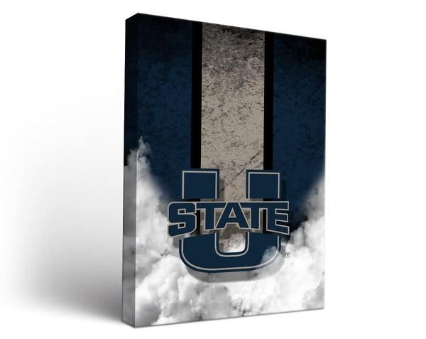 Stylish mixed media artwork with a retro flair for super fans of the Utah State Aggies! A bold varsity stripe and the College logo on a rustic background creates the stylish and handsome art print on canvas. Artist grade cotton, in vibrant, digitally dyed colors is stretched onto a solid wood frame, gallery depth frame. The result is a canvas art print that would look great in a TV room, man cave, game room or bedroom. Proudly made in the United States. FEATURES Stretched Canvas Art Prin...