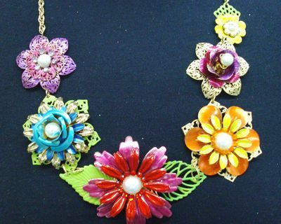Old jewelry pins painted with enamel nail polish and restrung as a necklace.