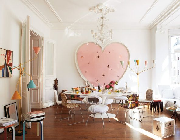 The dining area is anchored by a heart-shaped painting by Damien Hirst that Mike Meiré and his wife, Michelle Elie, bought as a wedding gift to themselves.