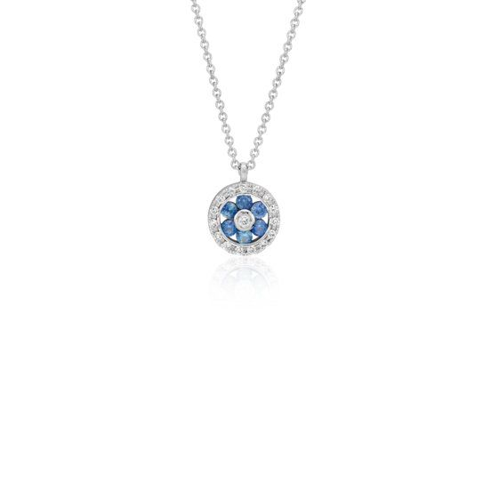Let your style shine bright with this dainty star pendant, delicately accented with vibrant sapphire gemstones, suspended from a 14k white gold cable chain necklace.