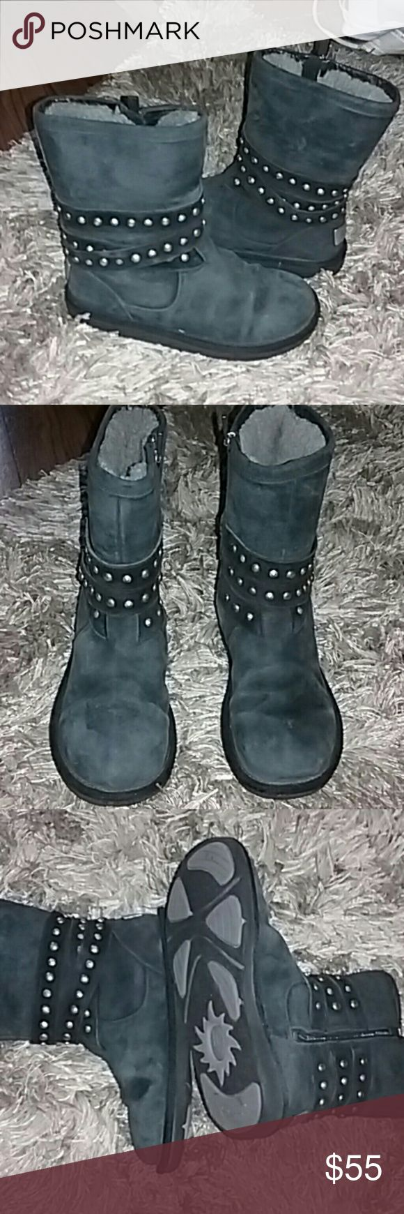 Women's Ugg boots size 6 Women's charcoal black Ugg boots style they are size 6 number 3329 they zip up the side and have a studded wrap around trim with silver metallic plaques in the back the fur inside is still very fluffy and very clean they are in good shape Ugg Shoes Ankle Boots & Booties