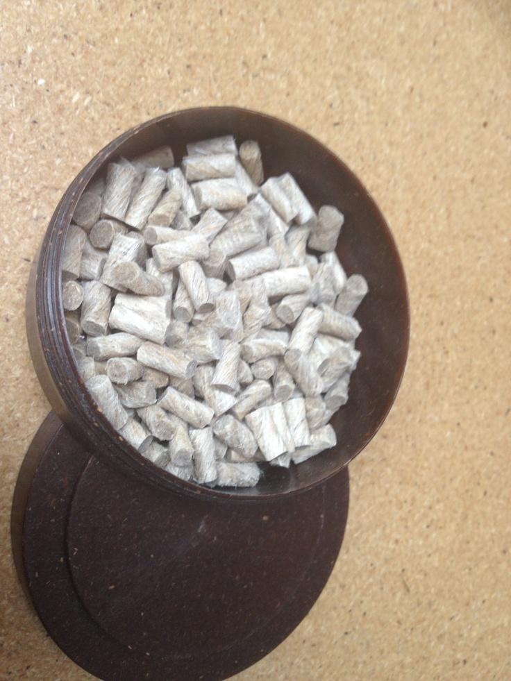 Hemp plastic pellets in a 100% hemp bowl on a hemp desk at the hemp farm.  www.hempplastic.com www.hempfarm.com.au