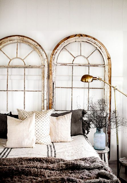 Love the beautiful old windows as bed headers seen at Fleaing France