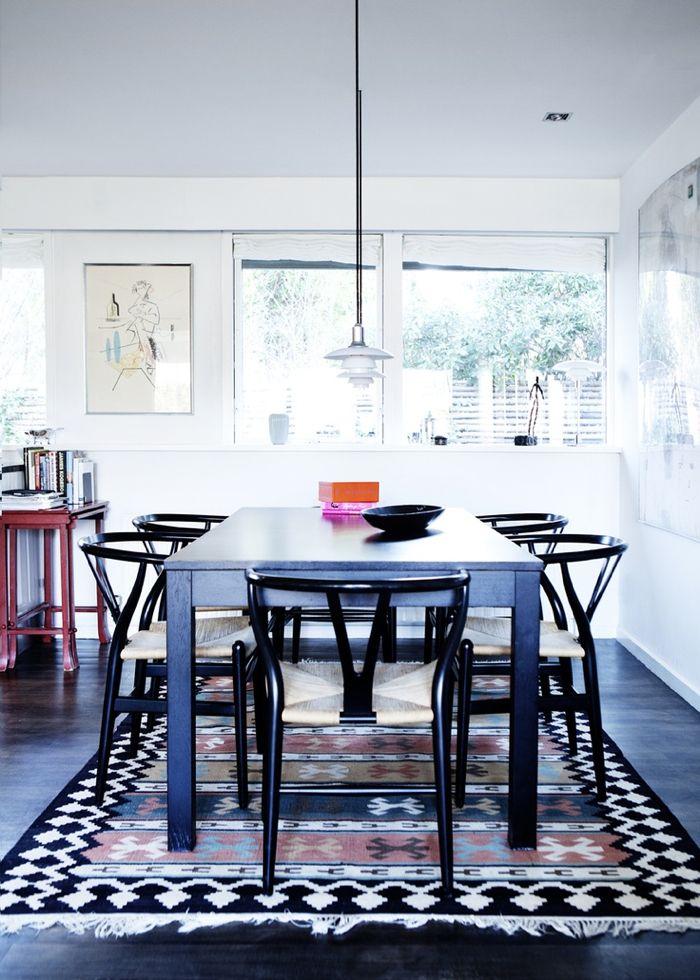 modern-dining-room-black-wishbone-chairs-kilim - Design Milk