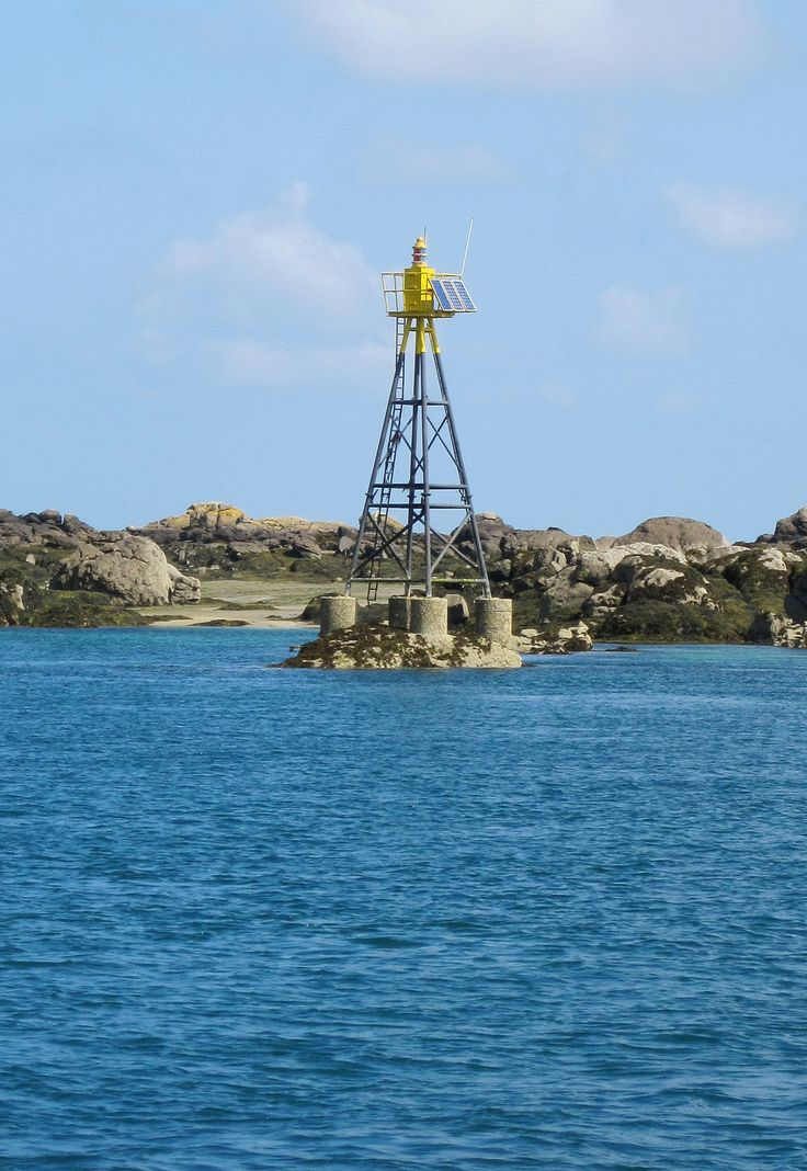 les Chausey Rock Warning France ... In and around the Iles Chausey are a number of rocks and shoals under the water. Many of these dangerous areas are marked with various types of warning signals. This photo is of one of the more prominent rock warning lights.
