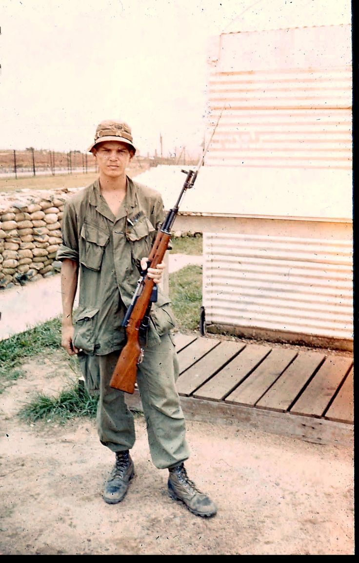 American soldier with a captured SKS (or Type 56) semi-automatic rifle.