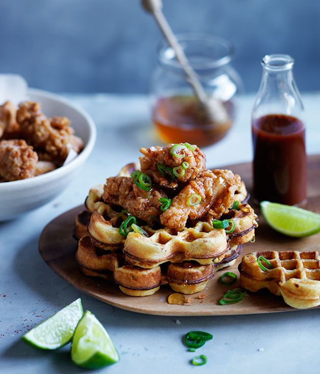 Spicy+cornmeal+waffles+with+popcorn+chicken,+honey+and+hot+sauce