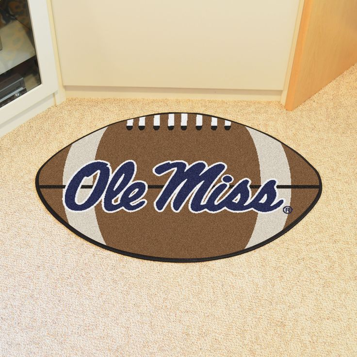 """University of Mississippi Football Rug 20.5x32.5 - For all those football fans out there: football-shaped area rugs by FANMATS. Made in U.S.A. 100% nylon carpet and non-skid recycled vinyl backing. Machine washable. Officially licensed. Chromojet printed in true team colors.FANMATS Series: FOOTBALTeam Series: University of Mississippi (Ole Miss) Product Dimensions: 20.5""""x32.5""""Shipping Dimensions: 22""""x18""""x0.5"""". Gifts > Licensed Gifts > Ncaa > All Colleges > University Of Mississippi Ole Miss…"""