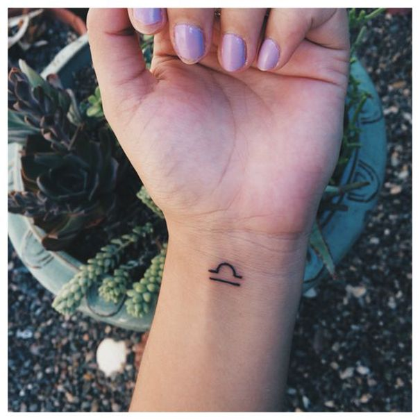 libra zodiac tattoo on wrist