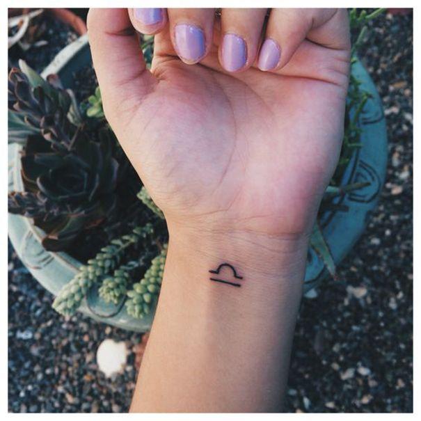 libra zodiac tattoo on wrist