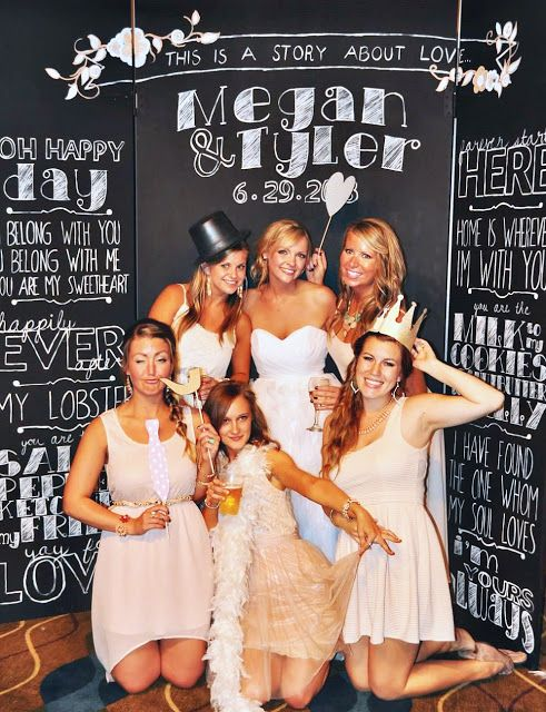 Chalkboard wedding photo booth with the bride and groom's story posted, great backdrop for the bride and bridesmaids photo shoot.
